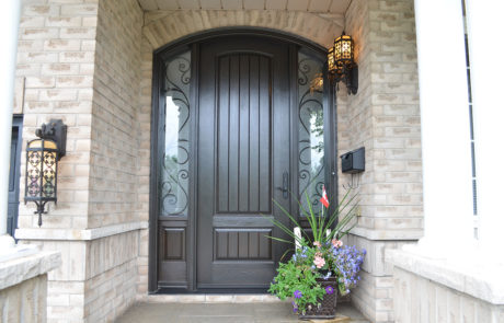 wrought iron arched front door